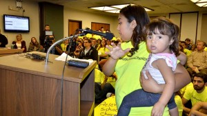 Charter school student Jaqueline Ramirez, 16, with daughter Aolanis. Photo by Ken Stone