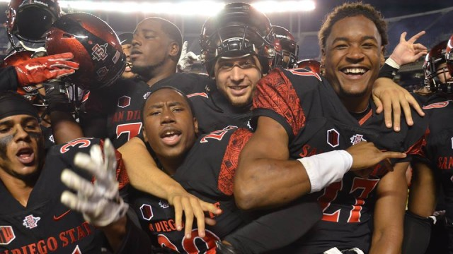 The San Diego State football team celebrates after beating University of Wyoming and becoming bowl-eligible for the sixth straight season. Courtesy of GoAztecs Facebook.