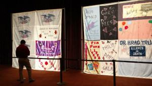A man contemplates a section of the AIDS Memorial Quilt. Photo by Chris Jennewein