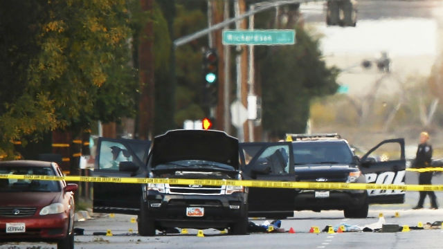 The body of one of the suspects lies outside the black SUV in which they tried to escape. Reuters photo
