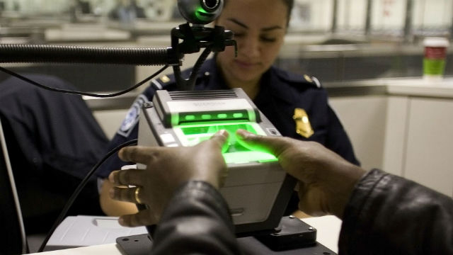 A Customs and Border Protection officers uses a fingerprint scanner. CBP photo