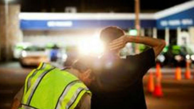 A CHP officer arrests a drunk driver. Courtesy CHP