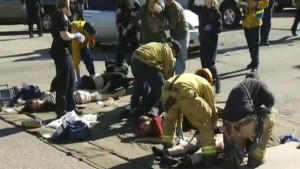 Paramedics treat the wounded outside the scene of the shootings. Reuters photo