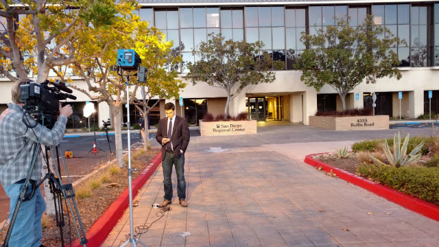 A TV crew outside the closed office of the San Diego Regional Center. Photo by Chris Jennewein