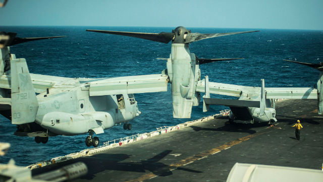 A V-22 Osprey tiltrotor takes off from the deck of the USS Essex. Navy photo