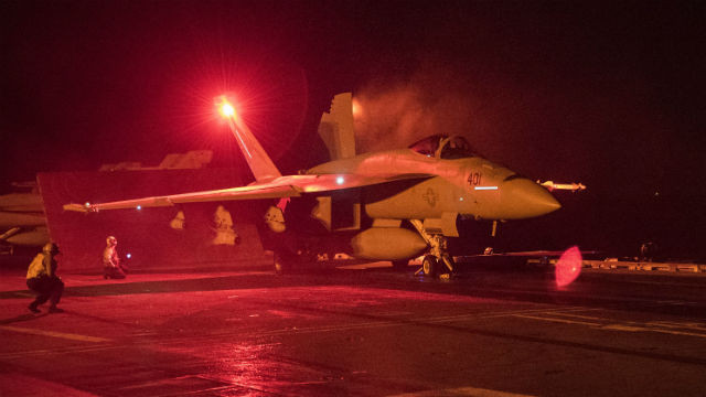 An F/A-18E Super Hornet prepares to launch from the flight deck of the aircraft carrier USS Harry S. Truman in the Arabian Gulf. Navy photo