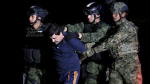 "Joaquín ""El Chapo"" Guzmán is escorted by soldiers in Mexico City after his arrest. REUTERS/Henry Romero"