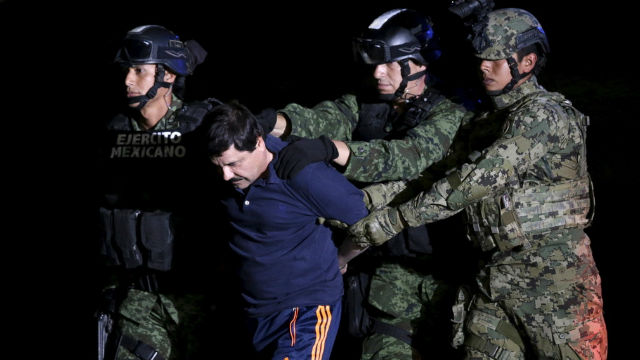 "Joaquín ""El Chapo"" Guzmán is escorted by soldiers in Mexico City after his arrest. REUTERS/Henry Romero"
