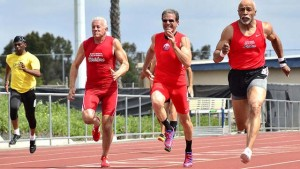 Greg Pizza (in sunglasses) races red-wearing teammates of the Southern California Striders — club President Joe Ruggless (left) and Damien Leake. Photo by Ken Stone