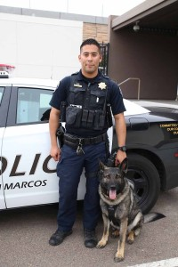 CSUSM bomb dog with Officer David Angulo, his K-9 Unit partner. Photo via CSU San Marcos