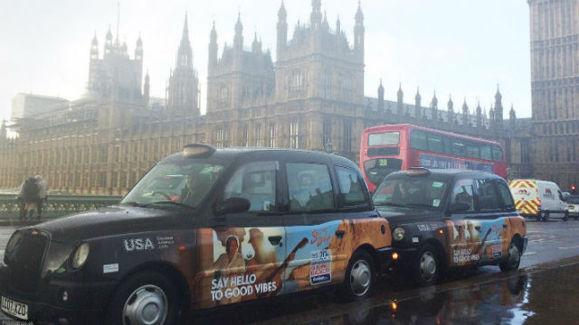 London taxis with San Diego ads on a gloomy winter day. Courtesy London Taxi Advertising