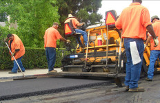 City employees repave a street. Photo courtesy City of San Diego