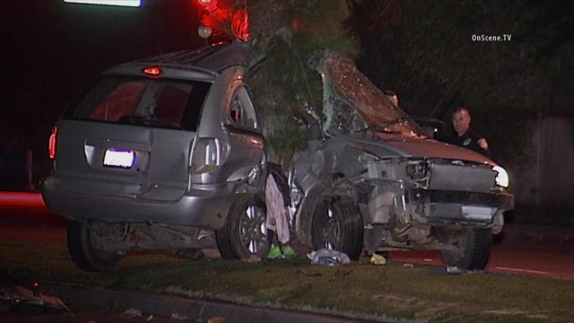 A 21-year-old driver was killed when his speeding minivan struck a tree off an Escondido roadway with such force it nearly split the vehicle in two. Photo via OnScene.TV.