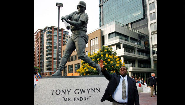 Former San Diego Padres player Tony Gwynn (bottom right) standing in front of the statue dedicated to the baseball hall of famer outside of Petco Park. (AP Photo/Denis Poroy)
