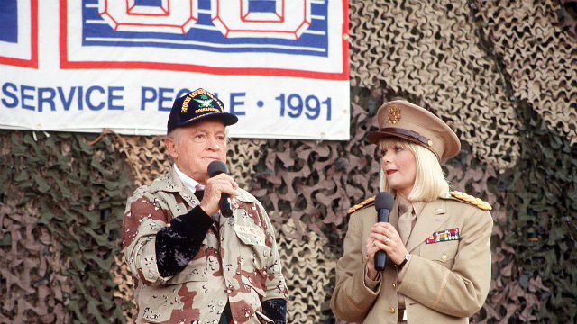 Bob Hope and Ann Jillian at a USO show during Desert Shield in 1991. Photo via Wikimedia Commons