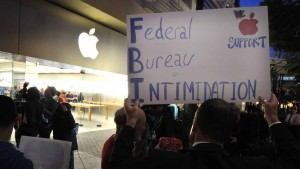 Rally participants displayed signs at Fashion Valley Apple Store in protest of FBI efforts to unlock iPhone of San Bernardino killer. Photo by Chris Stone