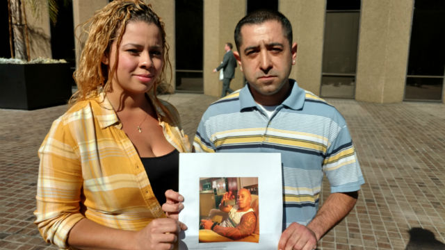 Nicole Leon and Jose Miranda with a photo of their friend Jamie Leonen. Photo by Chris Jennewein