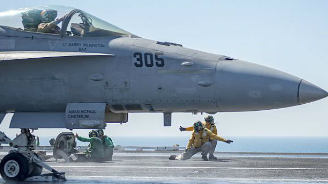 "An F/A-18C Hornet, assigned to the ""Rampagers"" of Strike Fighter Squadron 83 prepares to catapult from the flight deck of aircraft carrier USS Harry S. Truman in the Arabian Gulf. Navy photo"