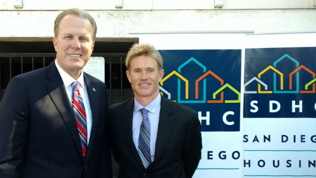 Landlord Chris Blatt (right) with Mayor Kevin Faulconer outside one of Blatt's properties. Photo by Chris Jennewein