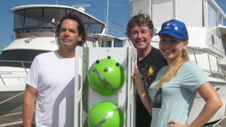 Rodney Moll (left), Kevin Hardy, and Natalya Gallo with a 'nanolander' developed to deploy deep-sea instruments. Photo courtesy Scripps Institution of Oceanography