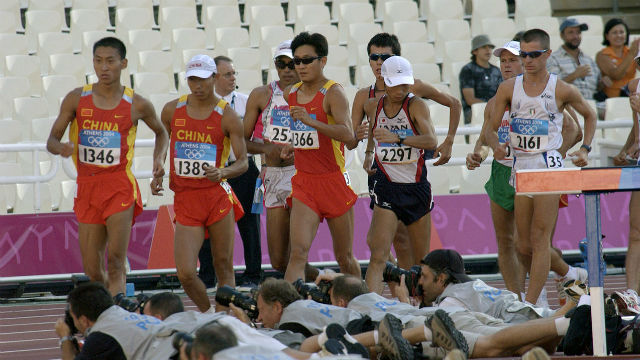 Photographers covering the racewalk in the 204 Olympics. Photo via Wikimedia Commons