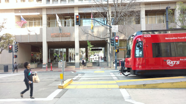 An MTS trolley outside City Hall in downtown San Diego. Photo by Chris Jennewein