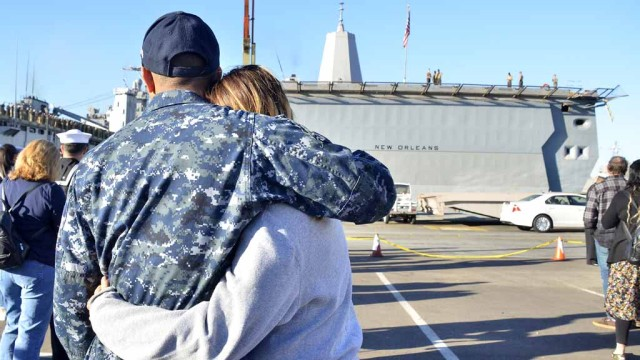 Couple hugs before deployment