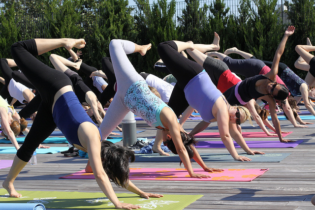 Yogis practice outside. Photo by Eli Christman via Flickr