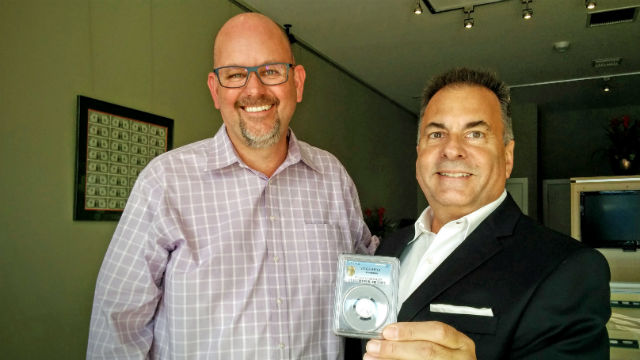 La Jolla Coin Shop Owner Michael McConnell (left) and Randall Lawrence with the aluminum penny.