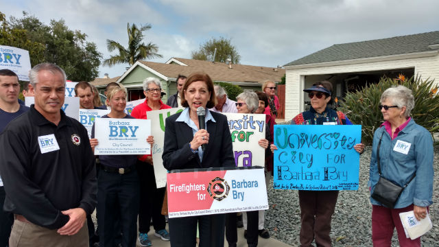 Barbara Bry speaks in front of the house housing a temporary fire station in University City. Photo by Chris Jennewein