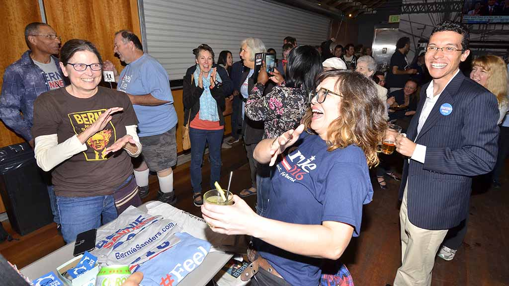 When CNN called Minnesota for Sanders, watch party-goers erupted in cheers and applause. Photo by Ken Stone