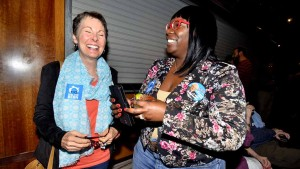 Brenda Hamilton (left) of South Park and San Diego newcomer Wendy Thompson were among 60 people attending watch party. Photo by Ken Stone
