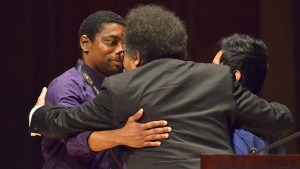 Cornel West at MiraCosta College Town Hall is embraced by student organizers after his talk. Photo by Ken Stone