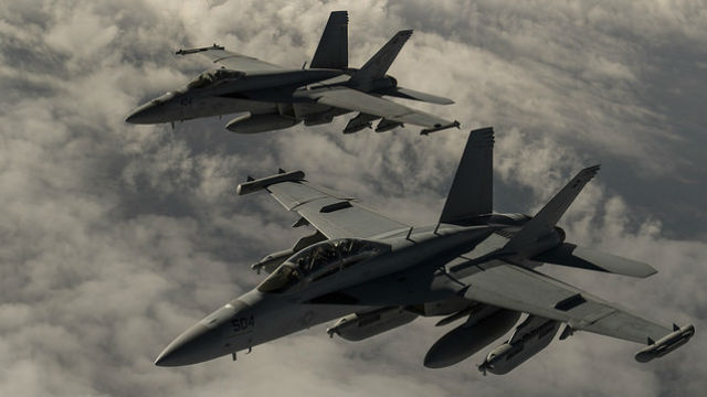 Two Navy F-18 Hornets patrol over Iraq in early March. Navy photo