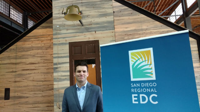 jason Kulpa, founder and CEO of Underground Elephant, stands in front of the schoolhouse-themed room in his company's new headquarters downtown. Photo by Chris Jennewein