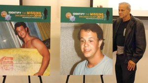 John Nellans with posters of his once-missing son, JP. Photo via County News Center