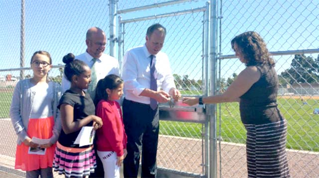 From left, Councilman Scott Sherman, Mayor Kevin Faulconer and schools Superintendent Cindy Marten unlock field of first city-schools park. Photo via Twitter