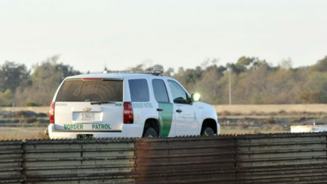 A Border Patrol agent monitors U.S.-Mexico border. Photo by Chris Stone