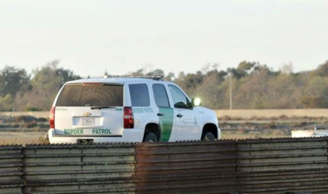 A Border Patrol agent monitors U.S.-Mexico border. Photo by Chris Stone