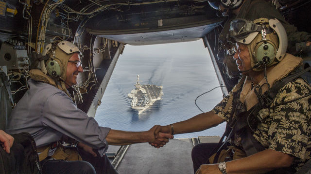 Secretary of Defense Ash Carter (left) and Philippine Secretary of National Defense Voltaire Gazmin shake hands on a Marine Corps V-22 Osprey as they depart the the aircraft carrier USS John C. Stennis. U.S. Air Force photo by Senior Master Sgt. Adrian Cadiz