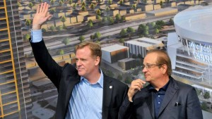 NFL Commissioner Roger Goodell and Chargers Chairman Dean Spanos acknowledge the crowd of fans. Photo by Chris Stone