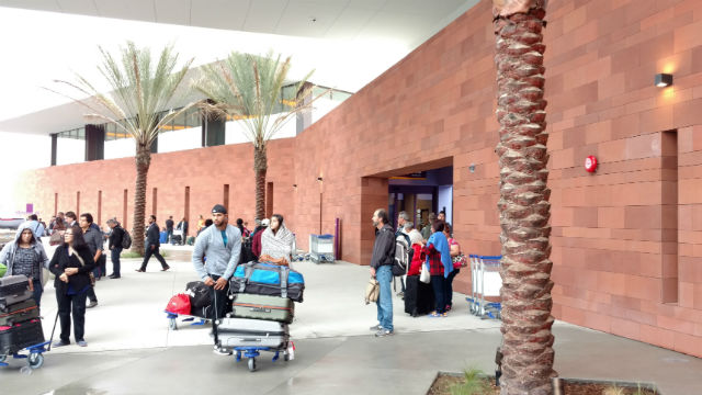 Airline passengers outside the Cross Border Xpress terminal on Thursday morning. Photo by Chris Jennewein