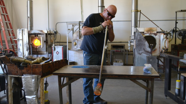 James Stone blows glass at his Escondido studio, April 12, 2016. Photo by Hoa Quach