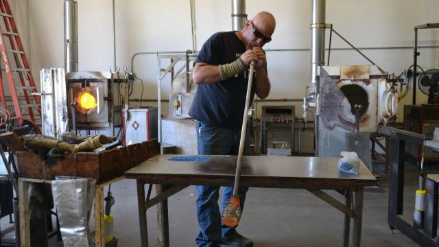 James Stone blows glass at his Escondido studio, April 12, 2016. Photo by Hoa Quach