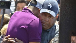 Salvador Martinez Hernandez hugs his son, Salvador, during a three-minute visit. Photo by Chris Stone