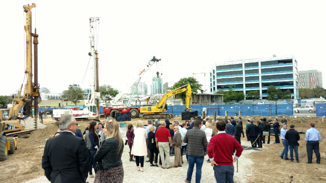 The crowd gathered at the construction site for the official groundbreaking. Photo by Chris Jennewein
