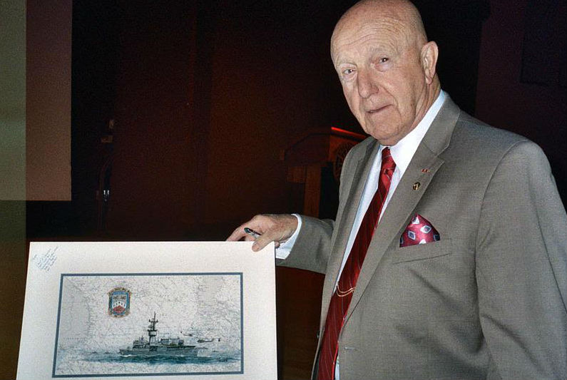 Navy Capt. Paul Jacobs with a drawing of the USS Kirk.