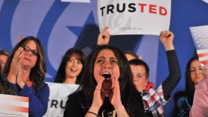 A supporter on stage voices her approval of a Ted Cruz comment. Photo by Chris Stone