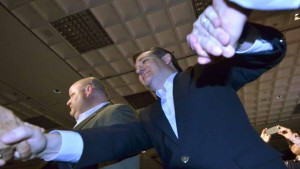 Texas Sen. Ted Cruz shakes hands with supporters at the beginning of his campaign rally. Photo by Chris Stone