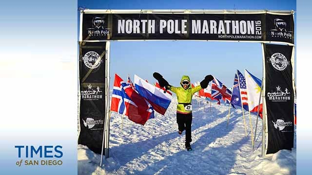 Vivian Lee raises her hands in triumph as she finishes the North Pole Marathon in temperatures well below zero. Photo by North Pole Marathon.
